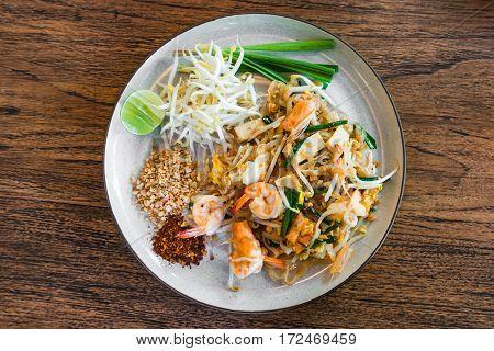 Shrimp Pad Thai Thai Food Thailand's national dishes on wood background