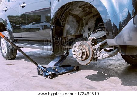 Changing Wheel And Brake On A Car By Jack