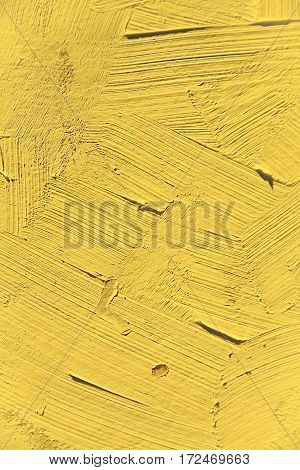 Painting close up of vivid primrose yellow pantone color, paint brush strokes  texture for interesting, creative, imaginative backgrounds. For web and design.