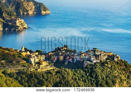 Corniglia village and Manarola in background at sunset. Seascape in Five lands Cinque Terre National Park Liguria Italy Europe.