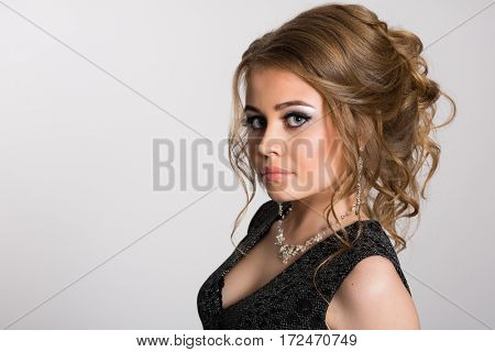 Beautiful young Russian woman on a gray background