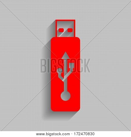 Vector USB flash drive sign. Vector. Red icon with soft shadow on gray background.