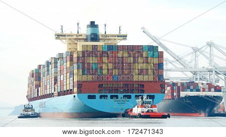 Oakland CA - January 31 2017: Cargo ship GEORG MAERSK entering the Port of Oakland the fifth busiest port in the United States.