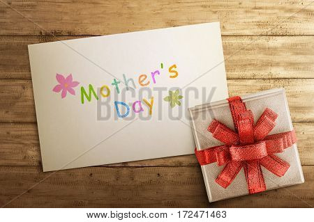 White Gift Box With Mother's Day Greeting On Paper