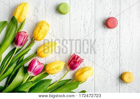 flowers spring tulips top view on wooden background.