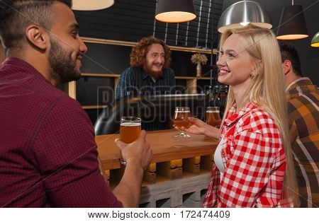 Young People Group In Bar, Couple Sitting At Wooden Counter Pub, Drink Beer Communication Party Celebration