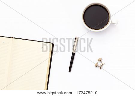 Open Black Diary With Pen And Cup Of Black Coffee On A White Background