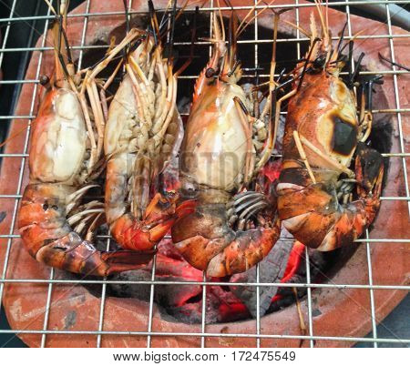 delicious shrimp prawn spit on grill with flames
