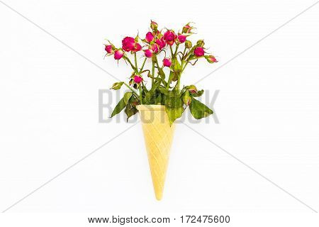 Waffle Cone With A Bouquet Of Roses On A White Background.