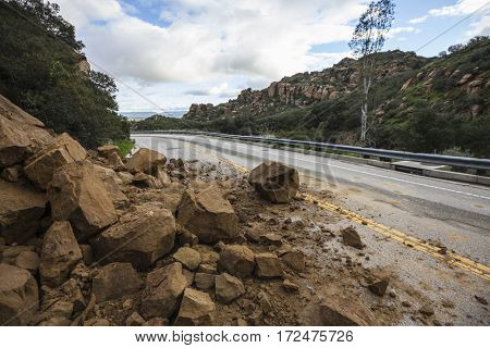 Rock slide blocking Santa Susana Pass Road in the west San Fernando Valley area of Los Angeles, California.