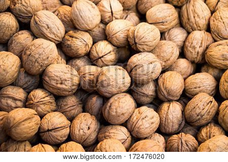 Pile Of Whole Walnuts  With Hard Nutshells
