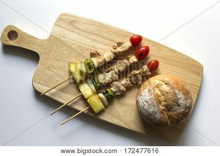 barbecue pork stick and bread on wooden. top view