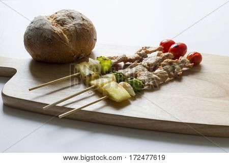 barbecue pork stick and bread on wooden