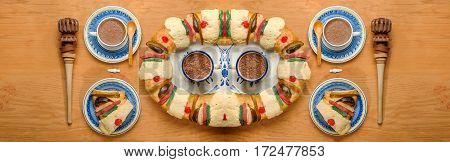 Epiphany cake Kings cake Roscon de reyes or Rosca de reyes with traditional mexican chocolate cup made with cinnamon