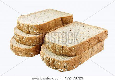 cut whole grain bread on white background