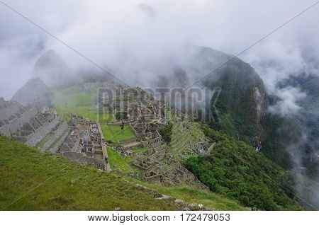 View Of The Lost Incan City Of Machu Picchu Near Cusco.low Clouds Cover Mountains. Cusco Region, Sac