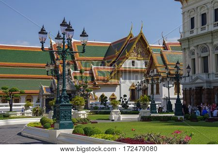 Bangkok, Thailand - July 25, 2010: Roayl Great (Grand) Palace Buddhist temple with famous green tree gardens in center of Bangkok Thailand