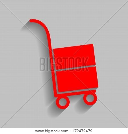 Hand truck sign. Vector. Red icon with soft shadow on gray background.