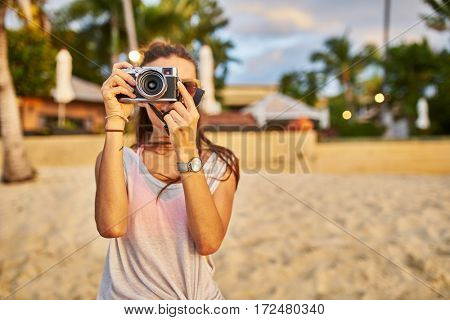 woman taking photo on beach in thailand