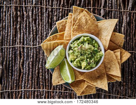 guacamole and tortilla chips flat lay composition with copyspace