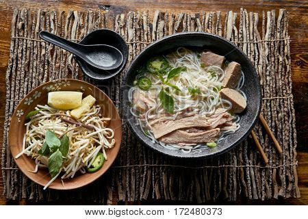 vietnamese pho with beef brisket in flat lay composition