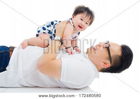 Asian father playing with his baby girl
