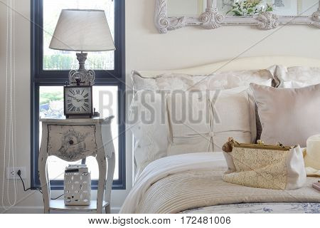 Luxury Bedroom Interior With Classic Style Table Lamp And Clock On Bedside Table