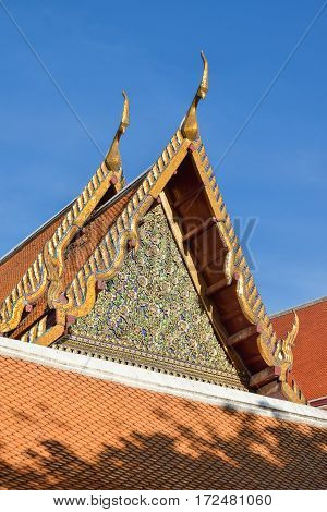 Thai temple roof Buddhism temple with blue sky