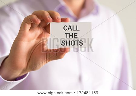 Businessman Holding A Card With Text Call The Shots