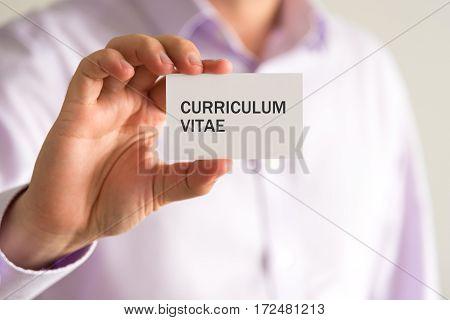 Businessman Holding A Card With Text Cv Curriculum Vitae