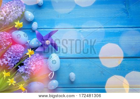 Easter egg,spring flower and pinwheel on wooden background