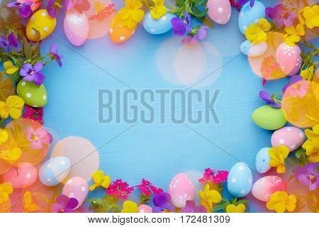 Easter egg and spring flower on blue background