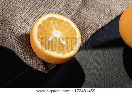 Juicy half of orange on wooden worktop