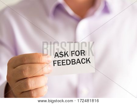 Businessman Holding A Card With Text Ask For Feedback