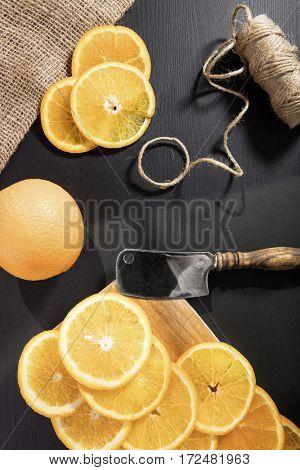 Orange and orange slices on the worktop