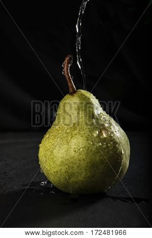 Fresh juicy wet pear on the table
