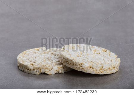 Two round rice waffles on worktop