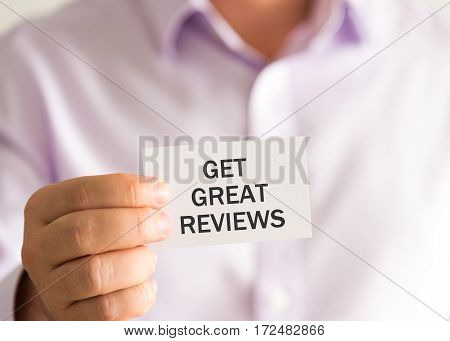 Businessman Holding A Card With Text Get Great Reviews