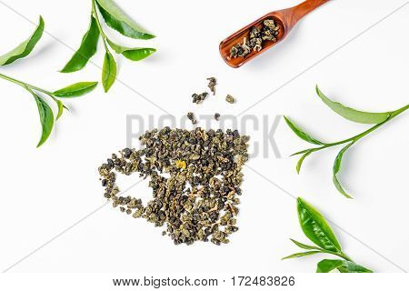 Tea Leaves And Wooden Scoop On White Background.