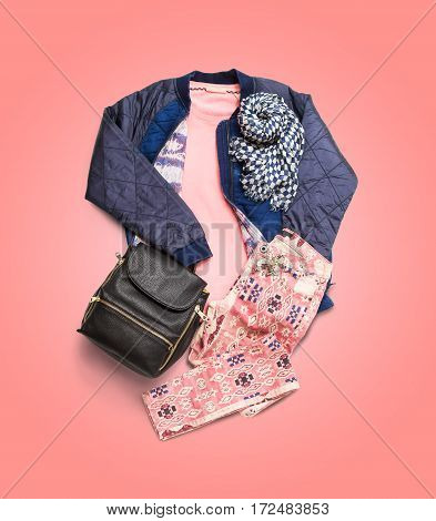 Women's clothing. Composition with jacket, backpack, scarf and pants