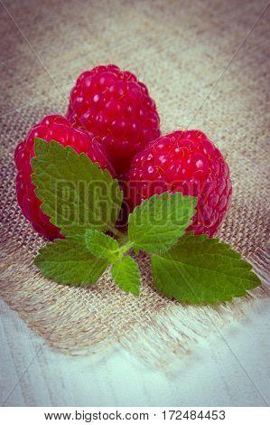 Vintage Photo, Fresh Raspberries And Lemon Balm On White Wooden Table, Healthy Food