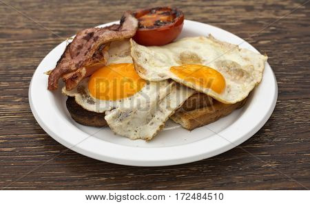 Classic Eggs Bacon and Tomato on Toast for breakfast in a food market stall