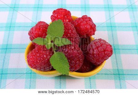 Fresh Raspberries And Lemon Balm On Checkered Tablecloth, Healthy Food