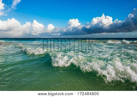 Highly detailed image of the waves crashing on the beach