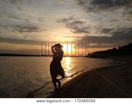 Sillhouette of woman at sunset near Volga river near Kazan, Russia: 15 July 2016
