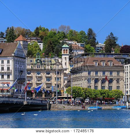 Lucerne, Switzerland - 8 May, 2016: people and buildings on Schwanenplatz square and Schweizerhof quay, view from Bahnhofquai quay. Lucerne is a city in central Switzerland, it is the capital of the Swiss canton of Lucerne.