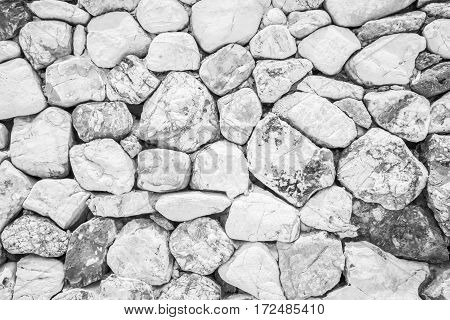 Stone walls lined up white beautiful.clouds,black and white