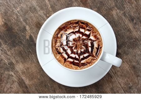 Top view a cup of coffee with some bubbles on wood texture clipping path