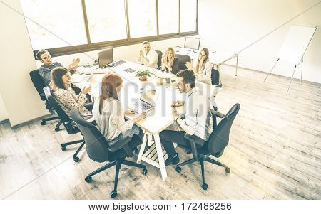 Group of young people employee coworkers at business meeting in urban coworking place studio - Human resources concept at working time - Start up entrepreneurs at office - Bright desaturated filter