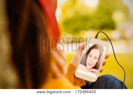 Portrait of pretty woman lying in bed against woman listening to music